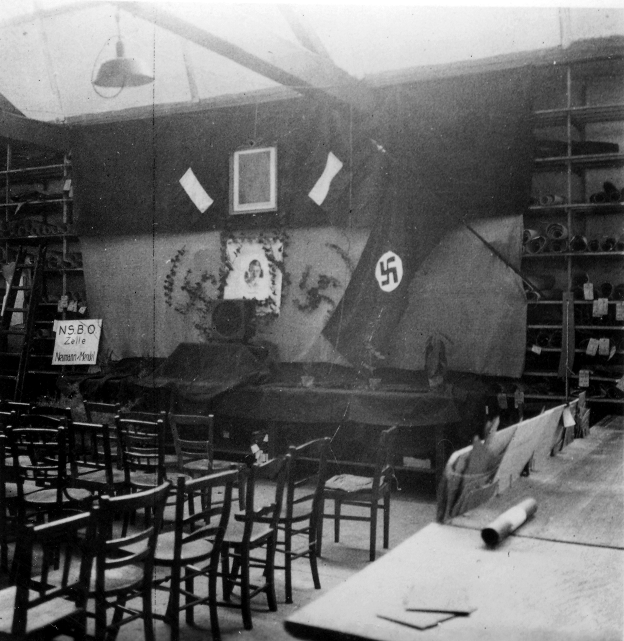 NSBO meeting room at Neumann & Mendel with nazi flag in the back. © Wiener Library Photo Collection.